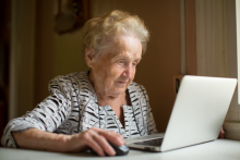 Woman using patient portal system at home.